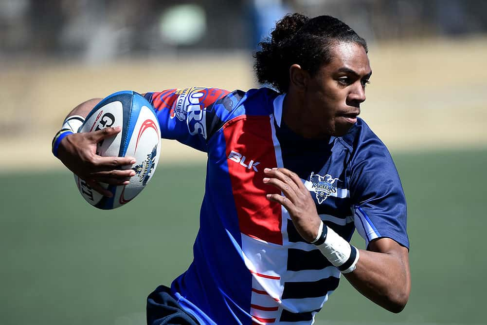 Raptors Academy Player Running With Rugby Ball